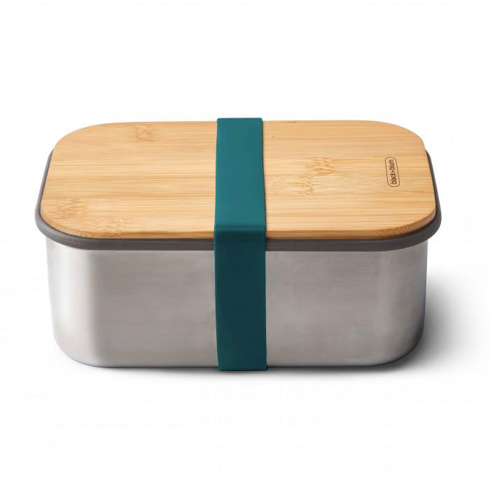 Sandwichbox 1,25 Liter von black&blum. Design Sandwichbox aus Edelstahl mit Holzdeckel aus Bambus. Aus der Serie Box Appetit. Mit Gummiband in in petrol blau.