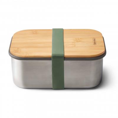 Große Lunchbox von black and blum Design. Sandwichbox aus Edelstahl mit Holzdeckel aus Bambus. Mit Gummizugband in olivegrün.